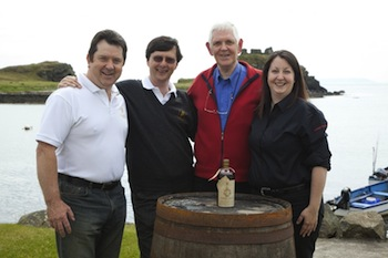 Four Lagavulin managers keep an eye on that 1911 bottle