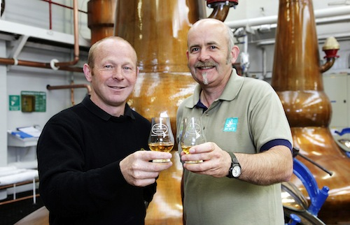 Glengoyne Distillery Manager Robbie Hughes and Learning Manager at WWT Caerlaverock , Dumfriesshire Brian Morrell toast the opening of Glengoyne's new wetlands area.