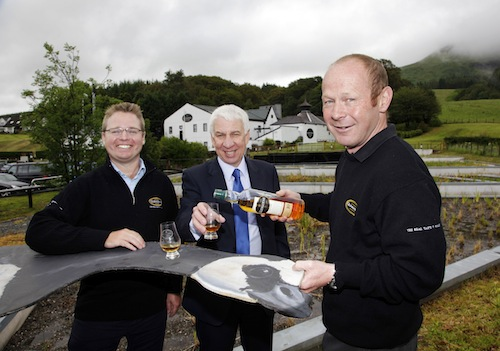 Glengoyne Marketing Director Iain Weir, WWT Corporate Relations Manager John Creedon and Glengoyne Distillery Manager Robbie Hughes toast the opening of Glengoyne's new wetlands area.