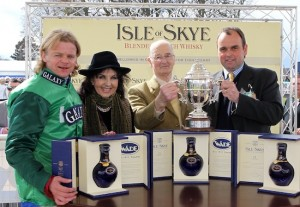 Trainer alan King (right)receives the Isle of Skye sponsored Scottish Champion Hurdle award after RAYA STAR and Choc Thornton won at Ayr