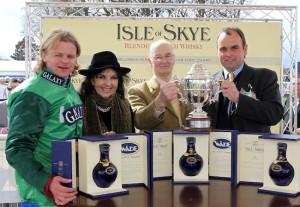Trainer alan King (right)receives the Isle of Skye sponsored Scottish Champion Hurdle award after RAYA STAR and Choc Thornton won at Ayr
