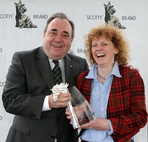 Trainer Lucinda Russell receives the Isle of Skye sponsored Leading Scottish Trainer award from First Minister Alex Salmond at Ayr