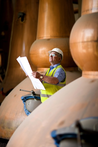 Operations manager Hamish Proctor looks over plans by Chivas Brothers to reopen Glen Keith Distillery in Speyside.