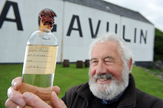 Donnie MacKinnon former head brewer at Lagavulin unveils the last remaining bottle of Malt Mill that he filled fifty years ago