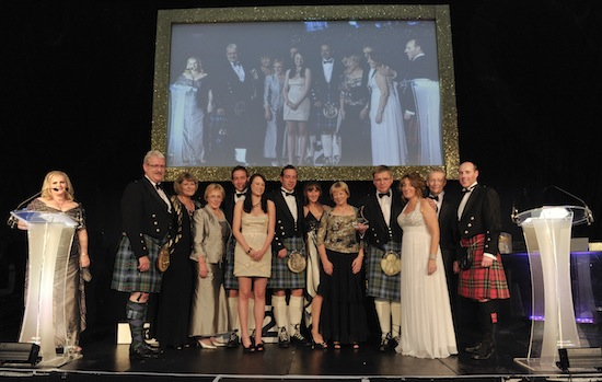 Daivd Urquhart pictured with Susan Young editor of The DRAM magazine and members of the Urquhart family