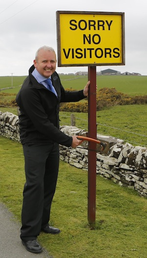 Brian MacAulay Removes Old Sign at Scapa Distillery